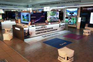 Full branding for Samsung trade area including  floor mats puffs wall coverings TV toppers stickers etc